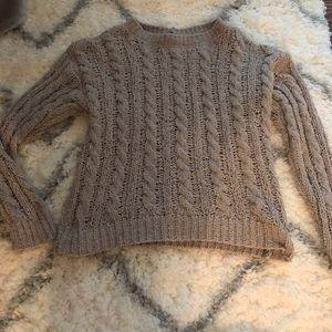 Tan colored sweater.